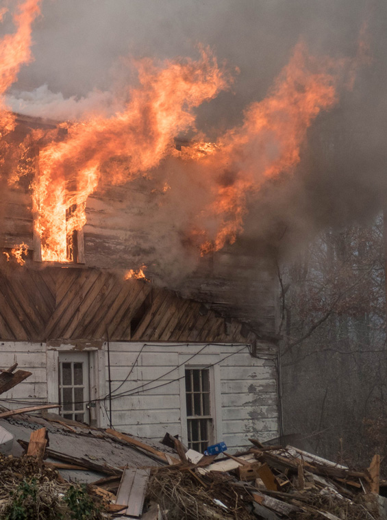 Flames shooting from house